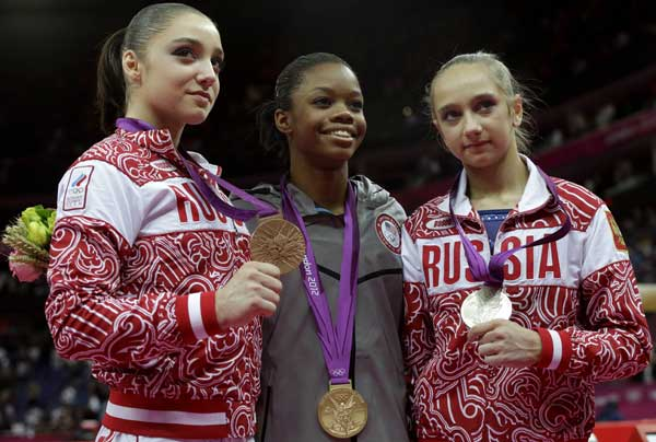U.S. gymnast and gold medallist Gabrielle Douglas, center, Russian gymnast and silver medallist Victoria Komova, right, and Russian gymnast and bronze medallist Aliya Mustafina stand on the podium during the artistic gymnastics women&#39;s individual all-around competition at the 2012 Summer Olympics, Thursday, Aug. 2, 2012, in London.  <span class=meta>(AP Photo&#47;Julie Jacobson)</span>