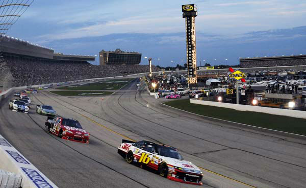 Greg Biffle &#40;16&#41; leads Tony Stewart &#40;14&#41; around Turn 1 at the NASCAR Sprint Cup Series auto race at Atlanta Motor Speedway, Sunday, Sept. 2, 2012, in Hampton, Ga. &#40;AP Photo&#47;David Tulis&#41; <span class=meta>(AP Photo&#47; David Tulis)</span>