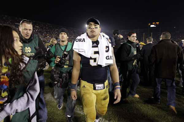 "<div class=""meta ""><span class=""caption-text "">Notre Dame linebacker Manti Te'o  during walks off the field following an NCAA college football game against Wake Forest in South Bend, Ind., Saturday, Nov. 17, 2012. (AP Photo/Michael Conroy) (AP Photo/ Michael Conroy)</span></div>"