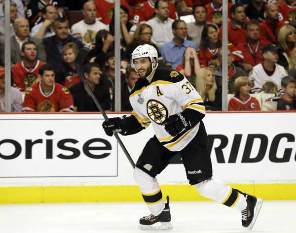 Boston Bruins center Patrice Bergeron &#40;37&#41; celebrates after scoring a goal against the Chicago Blackhawks during the third period of Game 1 in their NHL Stanley Cup Final hockey series on Wednesday, June 12, 2013, in Chicago. &#40;AP Photo&#47;Nam Y. Huh&#41; <span class=meta>(AP Photo&#47; Nam Y. Huh)</span>