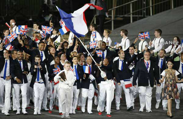 France&#39;s Laura Flessel-Colovic carries the flag during the Opening Ceremony at the 2012 Summer Olympics, Friday, July 27, 2012, in London. &#40;AP Photo&#47;Jae C. Hong&#41; <span class=meta>(AP Photo&#47; Jae C. Hong)</span>