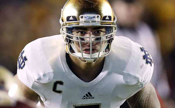 FILE - In this Nov. 10, 2012, file photo, Notre Dame linebacker Manti Te&#39;o waits for the snap during the second half of Notre Dame&#39;s 21-6 win over Boston College in a NCAA college football game in Boston. Te&#39;o is a finalist for the Heisman Trophy. &#40;AP Photo&#47;Winslow Townson, File&#41; <span class=meta>(AP Photo&#47; Winslow Townson)</span>