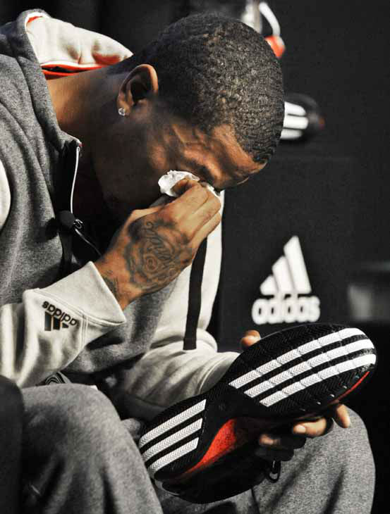 Chicago Bulls&#39; Derrick Rose breaks down and cries during a news conference unveiling his new shoe the Adidas D Rose 3 in Chicago, Thursday, Sept. 13, 2012. &#40;AP Photo&#47;Paul Beaty&#41; <span class=meta>(AP Photo&#47; Paul Beaty)</span>
