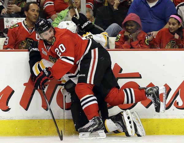Chicago Blackhawks left wing Brandon Saad &#40;20&#41; checks Boston Bruins defenseman Dennis Seidenberg &#40;44&#41; into the glass during the second period of Game 1 in their NHL Stanley Cup Final hockey series, Wednesday, June 12, 2013, in Chicago. &#40;AP Photo&#47;Nam Y. Huh&#41; <span class=meta>(AP Photo&#47; Nam Y. Huh)</span>