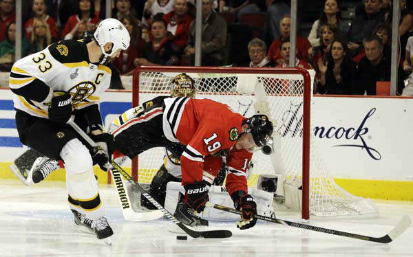 Boston Bruins defenseman Zdeno Chara &#40;33&#41; controls the puck against Chicago Blackhawks center Jonathan Toews &#40;19&#41; during the second period of Game 1 in their NHL Stanley Cup Final hockey series on Wednesday, June 12, 2013, in Chicago. &#40;AP Photo&#47;Nam Y. Huh&#41; <span class=meta>(AP Photo&#47; Nam Y. Huh)</span>