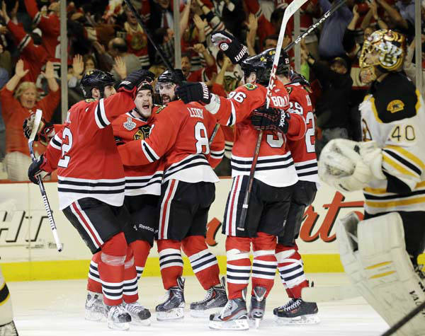 Chicago Blackhawks center Andrew Shaw, second from left, celebrates with his teammates after scoring the winning goal during the third overtime period of Game 1 in their NHL Stanley Cup Final hockey series against the Boston Bruins, Thursday, June 13, 2013, in Chicago. &#40;AP Photo&#47;Nam Y. Huh&#41; <span class=meta>(AP Photo&#47; Nam Y. Huh)</span>