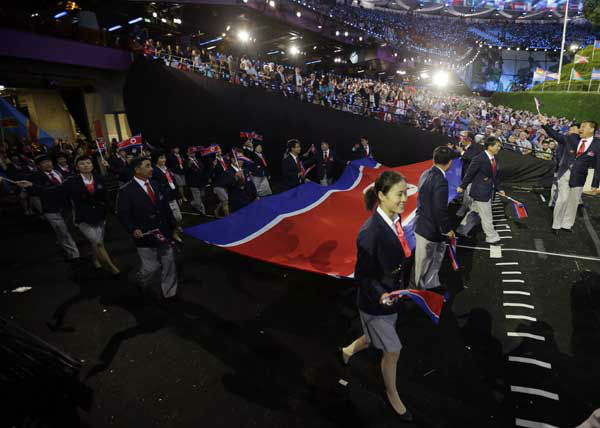 "<div class=""meta ""><span class=""caption-text "">North Korea's Olympic team arrives during the Opening Ceremony at the 2012 Summer Olympics, Friday, July 27, 2012, in London. (AP Photo/Matt Slocum) (AP Photo/ Matt Slocum)</span></div>"
