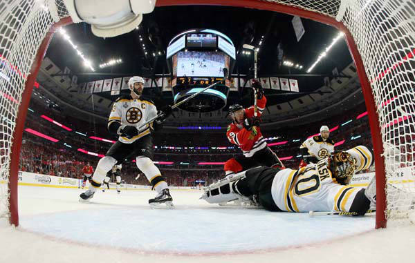 Boston Bruins goalie Tuukka Rask &#40;40&#41; makes a save on a shot by Chicago Blackhawks center Jonathan Toews &#40;19&#41; as Boston Bruins defenseman Zdeno Chara &#40;33&#41;  watches during the second period of Game 1 in their NHL Stanley Cup Final hockey series, Wednesday, June 12, 2013, in Chicago. &#40;AP Photo&#47;Bruce Bennett, Pool&#41; <span class=meta>(AP Photo&#47; Bruce Bennett)</span>