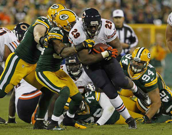 Chicago Bears running back Michael Bush us hit during a run by Green Bay Packers cornerback Tramon Williams during an NFL football game Thursday, Sept. 13, 2012, in Green Bay, Wis. &#40;AP Photo&#47;Matt Ludtke&#41; <span class=meta>(AP Photo&#47; Matt Ludtke)</span>