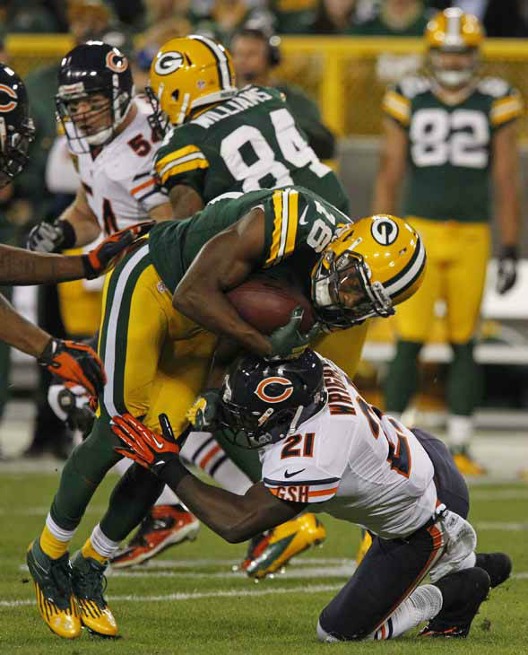 Green Bay Packers wide receiver Randall Cobb is hit by Chicago Bears strong safety Major Wright during an NFL football game Thursday, Sept. 13, 2012, in Green Bay, Wis. &#40;AP Photo&#47;Matt Ludtke&#41; <span class=meta>(AP Photo&#47; Matt Ludtke)</span>