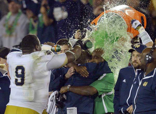 Notre Dame coach Brian Kelly, center left, is doused as he hugs an unidentified team member after Notre Dame defeated Southern California 22-13 in an NCAA college football game, Saturday, Nov. 24, 2012, in Los Angeles. &#40;AP Photo&#47;Mark J. Terrill&#41; <span class=meta>(AP Photo&#47; Mark J. Terrill)</span>