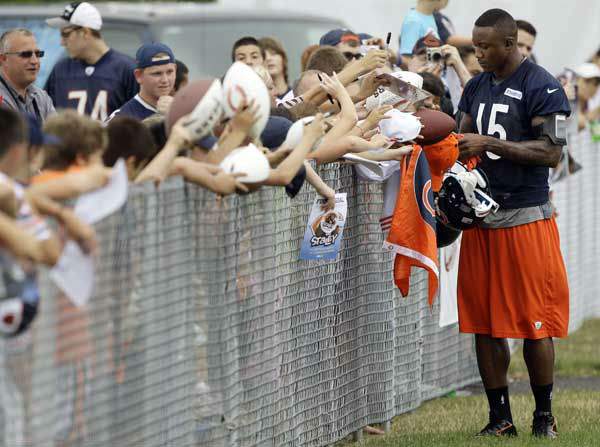 Chicago Bears wide receiver Brandon Marshall &#40;15&#41; signs autographs for fans during NFL football training camp at Olivet Nazarene University in Bourbonnais, Ill., Thursday, July 26, 2012. &#40;AP Photo&#47;Nam Y. Huh&#41; <span class=meta>(AP Photo&#47; Nam Y. Huh)</span>