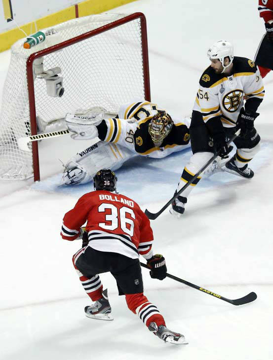 Chicago Blackhawks center Dave Bolland &#40;36&#41; scores a goal against Boston Bruins goalie Tuukka Rask &#40;40&#41; during the third period of Game 1 in their NHL Stanley Cup Final hockey series on Wednesday, June 12, 2013, in Chicago. &#40;AP Photo&#47;Charles Rex Arbogast&#41; <span class=meta>(AP Photo&#47; Charles Rex Arbogast)</span>