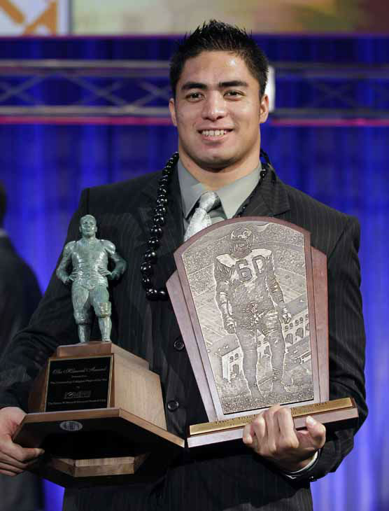 Notre Dame defensive back Manti Te&#39;o  displays his trophyies after being named the college defensive player of the year and the nation&#39;s college player of the year at the Home Depot College Football Awards in Lake Buena Vista, Fla., Thursday, Dec. 6, 2012. &#40;AP Photo&#47;John Raoux&#41; <span class=meta>(AP Photo&#47; John Raoux)</span>