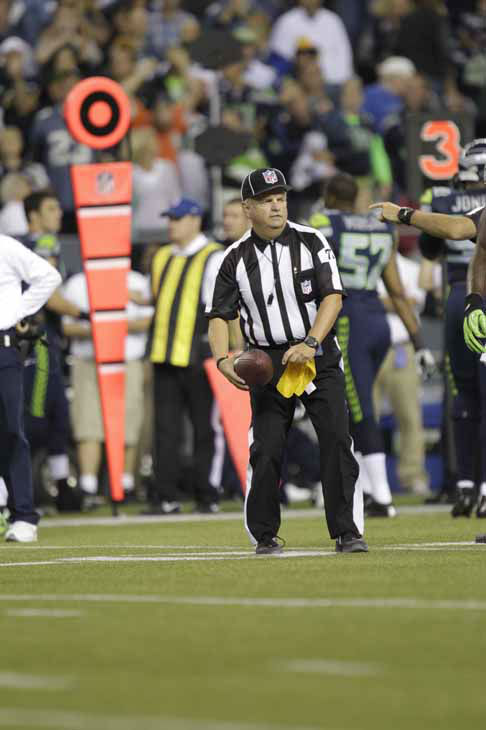 "<div class=""meta ""><span class=""caption-text "">An official during second half of an NFL football game between the Green Bay Packers and Seattle Seahawks, Monday, Sept. 24, 2012, in Seattle. (AP Photo/Ted S. Warren) (AP Photo/ Ted S. Warren)</span></div>"