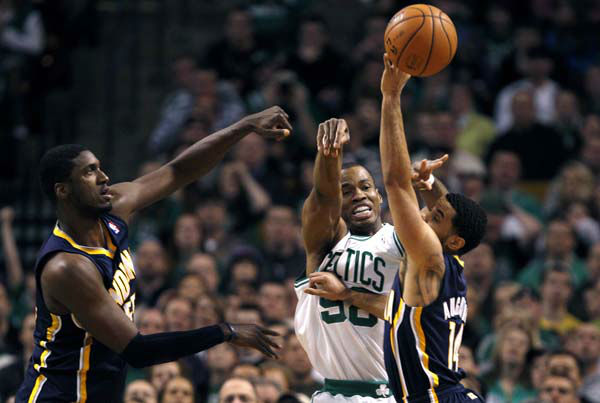 Boston Celtics center Jason Collins, center, dumps off the ball while pressured by Indiana Pacers center Roy Hibbert, left, and guard D.J. Augustin, right, during the first quarter of an NBA basketball game in Boston, Friday, Jan. 4, 2013. &#40;AP Photo&#47;Charles Krupa&#41; <span class=meta>(AP Photo&#47; Charles Krupa)</span>