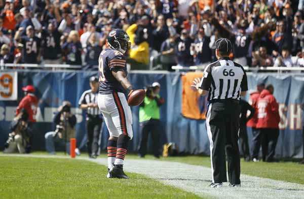 Chicago Bears running back Michael Bush &#40;29&#41; tosses the ball to an official after making a touchdown run in the first half of an NFL football game against the St. Louis Rams in Chicago, Sunday, Sept. 23, 2012. &#40;AP Photo&#47;Charles Rex Arbogast&#41; <span class=meta>(AP Photo&#47; Charles Rex Arbogast)</span>
