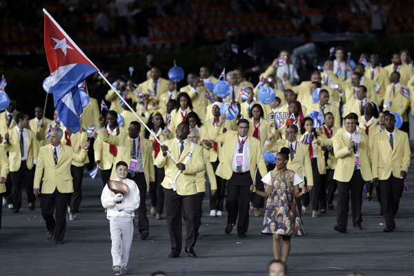 "<div class=""meta ""><span class=""caption-text "">Cuba's Mijain Lopez Nunez carries the flag during the Opening Ceremony at the 2012 Summer Olympics, Friday, July 27, 2012, in London. (AP Photo/Mark Humphrey) (AP Photo/ Mark Humphrey)</span></div>"