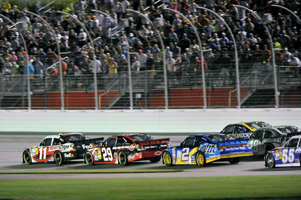 Denny Hamlin&#39;s Sport Clips Toyota Camry leads  during the NASCAR Sprint Cup Series auto race at Atlanta Motor Speedway, Sunday, Sept. 2, 2012, in Hampton, Ga.  Hamlin celebrated his second straight triumph Sunday night. &#40;AP Photo&#47;Autostock, Nigel Kinrade&#41; MANDATORY CREDIT <span class=meta>(AP Photo&#47; Nigel Kinrade)</span>