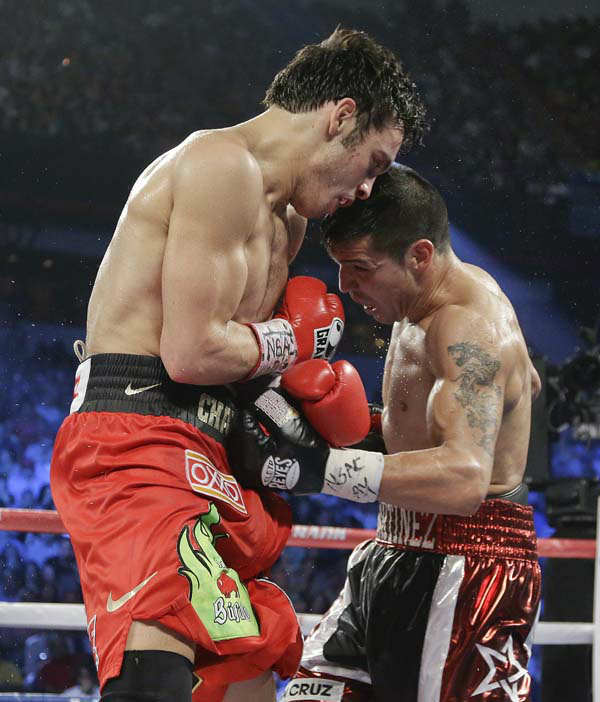 Sergio Martinez, right, lands a punch to thte body against Julio Cesar Chavez Jr. during the WBC middleweight title fight, Saturday, Sept. 15, 2012, in Las Vegas. Martinez won by unanimous decision. &#40;AP Photo&#47;Julie Jacobson&#41; <span class=meta>(AP Photo&#47; Julie Jacobson)</span>