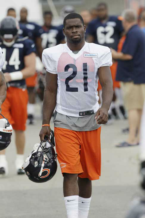 "<div class=""meta image-caption""><div class=""origin-logo origin-image ""><span></span></div><span class=""caption-text"">Chicago Bears safety Major Wright walks to the field during NFL football training camp at Olivet Nazarene University in Bourbonnais, Ill., Thursday, July 26, 2012. (AP Photo/Nam Y. Huh) (AP Photo/ Nam Y. Huh)</span></div>"