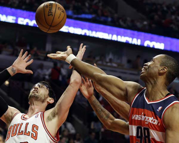 Washington Wizards center Jason Collins, right, battles for a rebound against Chicago Bulls guard Kirk Hinrich during the first half of an NBA basketball game in Chicago, Wednesday, April 17, 2013. &#40;AP Photo&#47;Nam Y. Huh&#41; <span class=meta>(AP Photo&#47; Nam Y. Huh)</span>