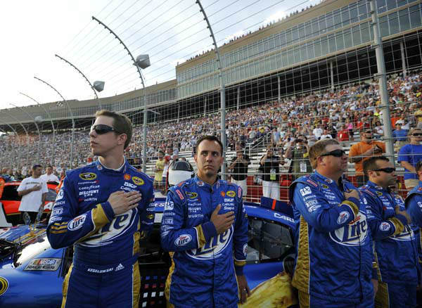 Brad Keselowski, left, stands by his car before the NASCAR Sprint Cup Series auto race at Atlanta Motor Speedway, Sunday, Sept. 2, 2012, in Hampton, Ga. &#40;AP Photo&#47;Rainier Ehrhardt&#41; <span class=meta>(AP Photo&#47; Rainier Ehrhardt)</span>