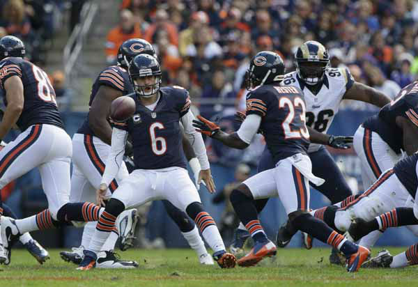 Chicago Bears quarterback Jay Cutler &#40;6&#41; toss the ball to wide receiver Devin Hester &#40;23&#41; in the first half of an NFL football game against the St. Louis Rams in Chicago, Sunday, Sept. 23, 2012. &#40;AP Photo&#47;Nam Y. Huh&#41; <span class=meta>(AP Photo&#47; Nam Y. Huh)</span>