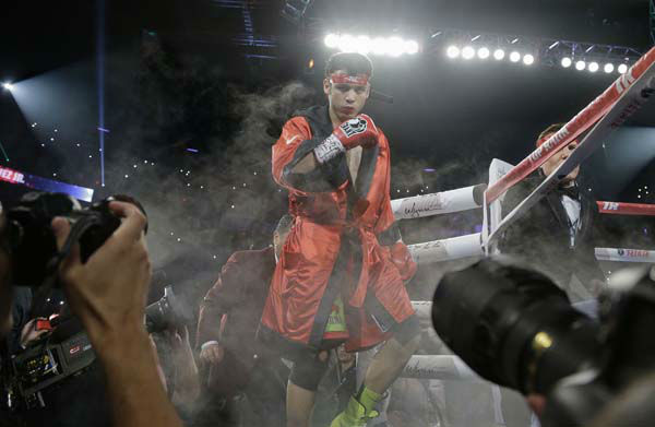 Julio Cesar Chavez Jr. enters the ring before fighting Sergio Martinez for the WBC middleweight title fight, Saturday, Sept. 15, 2012, in Las Vegas. Martinez won by unanimous decision. &#40;AP Photo&#47;Julie Jacobson&#41; <span class=meta>(AP Photo&#47; Julie Jacobson)</span>