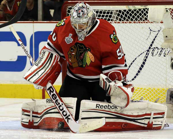 Chicago Blackhawks goalie Corey Crawford &#40;50&#41; makes a save during the second overtime period of Game 1 in their NHL Stanley Cup Final hockey series against the Boston Bruins, Wednesday, June 12, 2013, in Chicago. &#40;AP Photo&#47;Nam Y. Huh&#41; <span class=meta>(AP Photo&#47; Nam Y. Huh)</span>