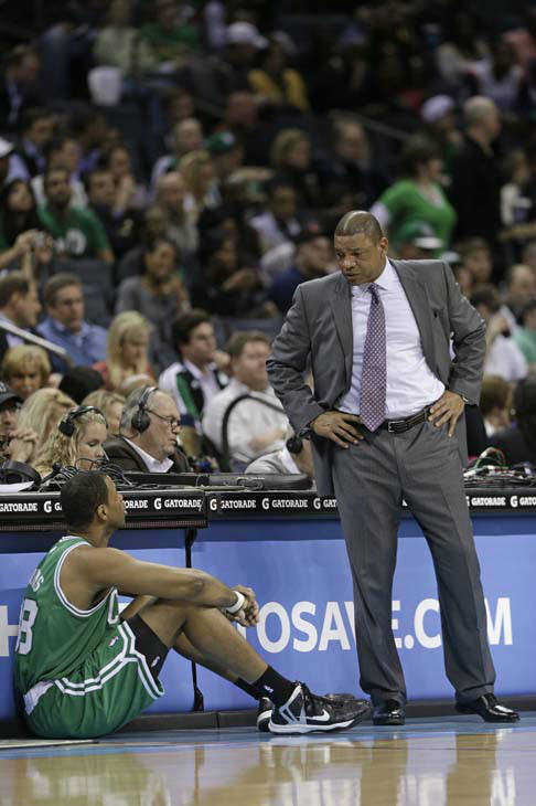 Boston Celtics head coach Doc Rivers, right, talks with Jason Collins, left, during the first half of an NBA basketball game against the Charlotte Bobcats in Charlotte, N.C., Monday, Feb. 11, 2013. &#40;AP Photo&#47;Chuck Burton&#41; <span class=meta>(AP Photo&#47; Chuck Burton)</span>