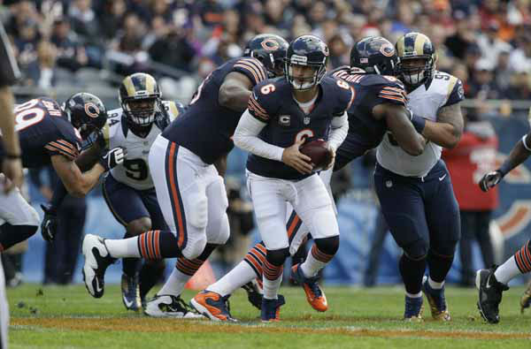 Chicago Bears quarterback Jay Cutler &#40;6&#41; looks to hand the ball off in the first half of an NFL football game against the St. Louis Rams in Chicago, Sunday, Sept. 23, 2012. &#40;AP Photo&#47;Nam Y. Huh&#41; <span class=meta>(AP Photo&#47; Nam Y. Huh)</span>
