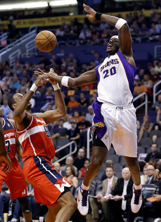 Washington Wizards&#39; Jason Collins fouls Phoenix Suns&#39; Jermaine O&#39;Neal during the second half of an NBA basketball game, Wednesday, March 20, 2013, in Phoenix. The Wizards won 88-79. &#40;AP Photo&#47;Matt York&#41; <span class=meta>(AP Photo&#47; Matt York)</span>