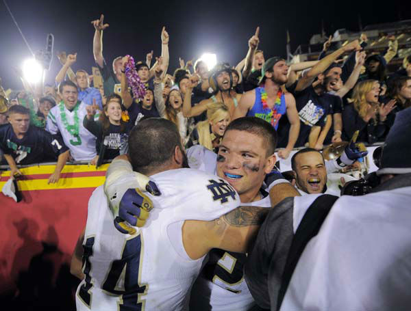 Notre Dame linebacker Carlo Calabrese, left, celebrates with center Braxston Cave after Notre Dame defeated Southern California 22-13 in an NCAA college football game, Saturday, Nov. 24, 2012, in Los Angeles. &#40;AP Photo&#47;Mark J. Terrill&#41; <span class=meta>(AP Photo&#47; Mark J. Terrill)</span>