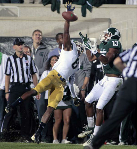 Notre Dame&#39;s KeiVarae Russell, left, knocks away a pass in the end zone intended for Michigan State&#39;s Bennie Fowler &#40;13&#41; during the first quarter of an NCAA college football game, Saturday, Sept. 15, 2012, in East Lansing, Mich. &#40;AP Photo&#47;Al Goldis&#41; <span class=meta>(AP Photo&#47; Al Goldis)</span>