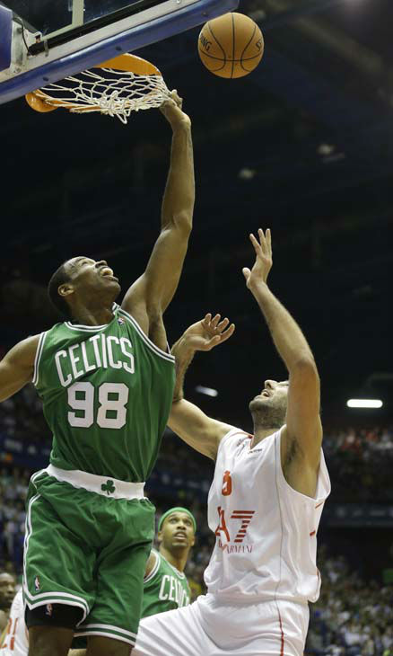 EA7 Emporio Armani&#39;s Ioannis Bourousis, right, drives against Boston Celtics&#39; Jason Collins, during an exhibition basketball game in Milan, Italy, Sunday, Oct. 7, 2012. &#40;AP Photo&#47;Luca Bruno&#41; <span class=meta>(AP Photo&#47; Luca Bruno)</span>