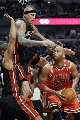 Chicago Bulls forward Taj Gibson &#40;22&#41; looks to the basket against Miami Heat forward Chris Andersen, top, and forward Shane Battier during the second half of an NBA basketball game in Chicago on Wednesday, March 27, 2013. The Bulls won 101-97, ending the Heat&#39;s 27-game winning streak. &#40;AP Photo&#47;Nam Y. Huh&#41; <span class=meta>(AP Photo&#47; Nam Y. Huh)</span>
