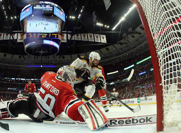 Chicago Blackhawks goalie Corey Crawford &#40;50&#41; makes a save on a shot by Boston Bruins left wing Milan Lucic &#40;17&#41; during the second overtime period of Game 1 in their NHL Stanley Cup Final hockey series, Wednesday, June 12, 2013, in Chicago. The Blackhawks won 4-3. &#40;AP Photo&#47;Bruce Bennett, Pool&#41; <span class=meta>(AP Photo&#47; Bruce Bennett)</span>