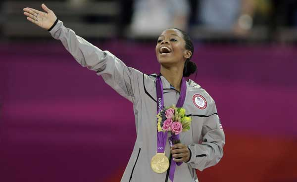 U.S. gymnast Gabrielle Douglas acknowledges the crowd after receiving her gold medal during the artistic gymnastics women&#39;s individual all-around competition at the 2012 Summer Olympics, Thursday, Aug. 2, 2012, in London.  <span class=meta>(AP Photo&#47;Gregory Bull)</span>