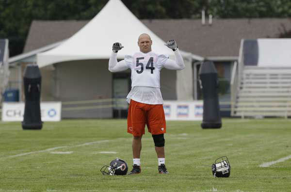 "<div class=""meta ""><span class=""caption-text "">Chicago Bears linebacker Brian Urlacher (54) stretches as he watches teammates practice during NFL football training camp at Olivet Nazarene University in Bourbonnais, Ill., Thursday, July 26, 2012. (AP Photo/Nam Y. Huh) (AP Photo/ Nam Y. Huh)</span></div>"