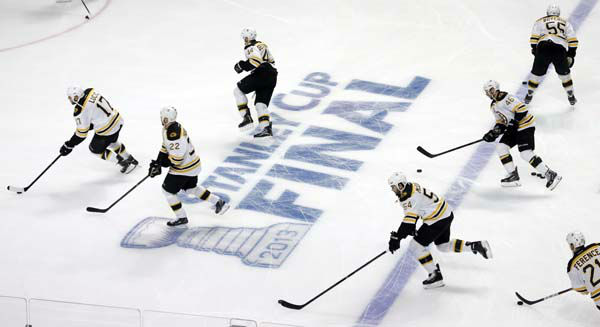 Boston Bruins players warm up before Game 1 in their NHL Stanley Cup Final hockey series against the Chicago Blackhawks, Wednesday, June 12, 2013 in Chicago. &#40;AP Photo&#47;Charles Rex Arbogast&#41; <span class=meta>(AP Photo&#47; Charles Rex Arbogast)</span>