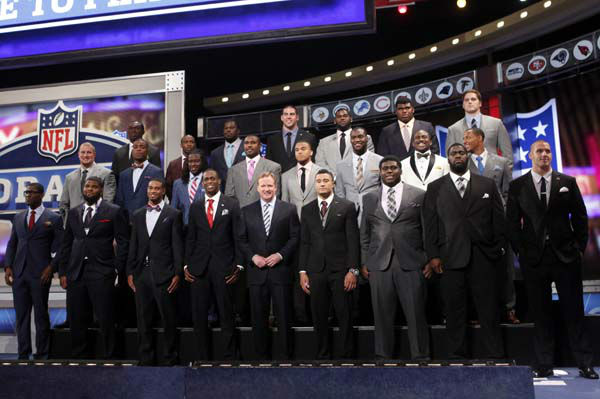 "<div class=""meta image-caption""><div class=""origin-logo origin-image ""><span></span></div><span class=""caption-text"">The top NFL football draft prospects pose for a group photo with Commissioner Roger Goodell, front row center, before the first round, Thursday, April 25, 2013, at Radio City Music Hall in New York. (AP Photo/Jason DeCrow) (AP Photo/ Jason DeCrow)</span></div>"