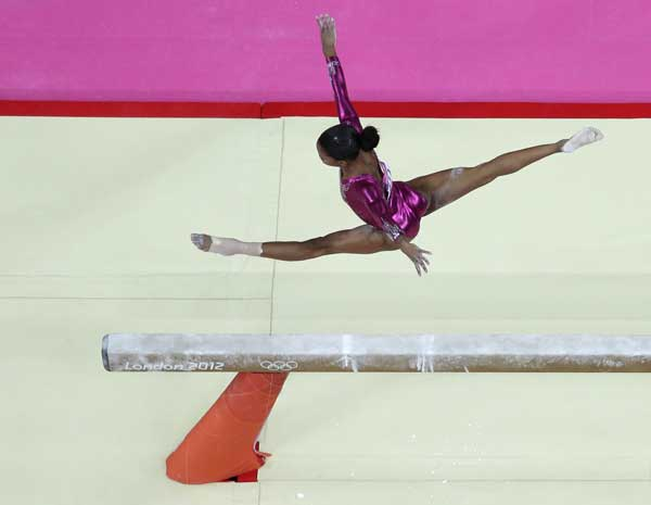 U.S. gymnast Gabrielle Douglas performs on the balance beam during the artistic gymnastics women&#39;s individual all-around competition at the 2012 Summer Olympics, Thursday, Aug. 2, 2012, in London.  <span class=meta>(AP Photo&#47;Julie Jacobson)</span>