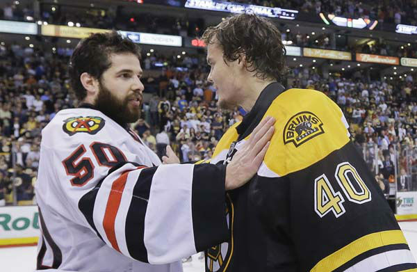 Chicago Blackhawks goalie Corey Crawford &#40;50&#41; is congratulated by Boston Bruins goalie Tuukka Rask &#40;40&#41;, of Finland, after the Blackhawks beat the Boston Bruins 3-2 in Game 6 of the NHL hockey Stanley Cup Finals Monday, June 24, 2013, in Boston. &#40;AP Photo&#47;Elise Amendola&#41; <span class=meta>(AP Photo&#47; Elise Amendola)</span>