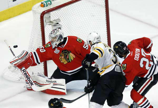 Chicago Blackhawks goalie Corey Crawford &#40;50&#41; makes a save during the first overtime period of Game 1 in their NHL Stanley Cup Final hockey series against the Boston Bruins, Wednesday, June 12, 2013 in Chicago. &#40;AP Photo&#47;Charles Rex Arbogast&#41; <span class=meta>(AP Photo&#47; Charles Rex Arbogast)</span>