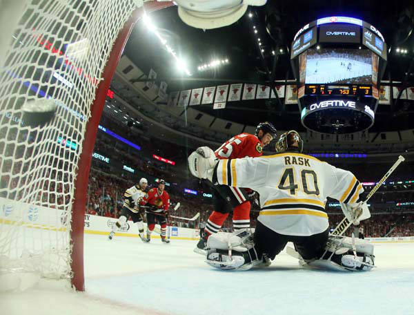 The puck flies into the net as Chicago Blackhawks center Andrew Shaw &#40;65&#41; scores the game winning goal against Boston Bruins goalie Tuukka Rask &#40;40&#41; during the third overtime period of Game 1 in their NHL Stanley Cup Final hockey series, Wednesday, June 12, 2013, in Chicago. The Blackhawks won 4-3. &#40;AP Photo&#47;Bruce Bennett, Pool&#41; <span class=meta>(AP Photo&#47; Bruce Bennett)</span>