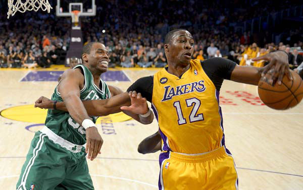 Los Angeles Lakers center Dwight Howard &#40;12&#41; battles Boston Celtics center Jason Collins for a rebound during the first half of their NBA basketball game, Wednesday, Feb. 20, 2013, in Los Angeles. &#40;AP Photo&#47;Mark J. Terrill&#41; <span class=meta>(AP Photo&#47; Mark J. Terrill)</span>