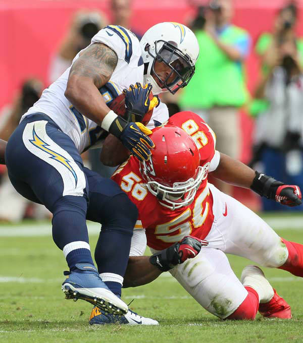 San Diego Chargers running back Ryan Mathews &#40;24&#41; is tackled by Kansas City Chiefs linebacker Jovan Belcher &#40;59&#41; and linebacker Derrick Johnson &#40;56&#41; in the 4th quarter of the their NFL game, Sunday, Sept. 30, 2012, in Kansas City, Mo. The Chargers defeated the Chiefs 37-20. &#40;AP Photo&#47;Colin E Braley&#41; <span class=meta>(AP Photo&#47; Colin E Braley)</span>