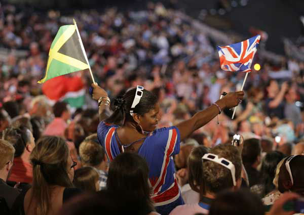 A spectator waves a flag of Great Britain, right, and Jamaica during the Opening Ceremony at the 2012 Summer Olympics, Friday, July 27, 2012, in London. &#40;AP Photo&#47;Markus Schreiber&#41; <span class=meta>(AP Photo&#47; Markus Schreiber)</span>
