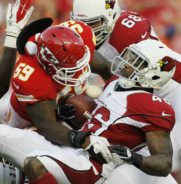 Arizona Cardinals running back Alfonso Smith &#40;46&#41; is tackled by Kansas City Chiefs linebacker Jovan Belcher &#40;59&#41; during an NFL preseason football game in Kansas City, Mo., Friday, Aug. 10, 2012. &#40;AP Photo&#47;Colin E. Braley&#41; <span class=meta>(AP Photo&#47; Colin E. Braley)</span>